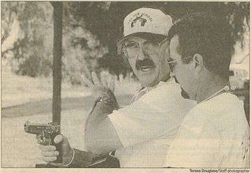 Top photo: Instructor Dan Wells, left, gives some pointers to Ron Deal of Tulare at the Visalia police shooting range northwest of Visalia. Wells teaches four-hour and 16-hour classes on guns.
