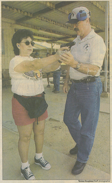 Mary Ellen of Tulare gets instruction from Dan Wells at the Visalia police shooting range. Ellen has applied for a concealed weapon permit.